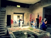 Inside one of the mansions. The bath and the bright painted walls show this as belonging to a rich family.
