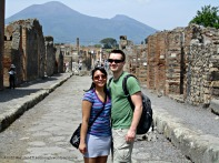 Vesuvius looks innocent in the background as we stand at one of Pompeii's streets.